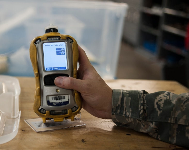 U.S. Air Force Staff Sgt. Adrian Gonzalez, an aircraft fuel systems craftsman assigned to the 6th Maintenance Squadron calibrates a photoionization detector used during fuel systems maintenance at MacDill Air Force Base, Fla., May 30, 2018.