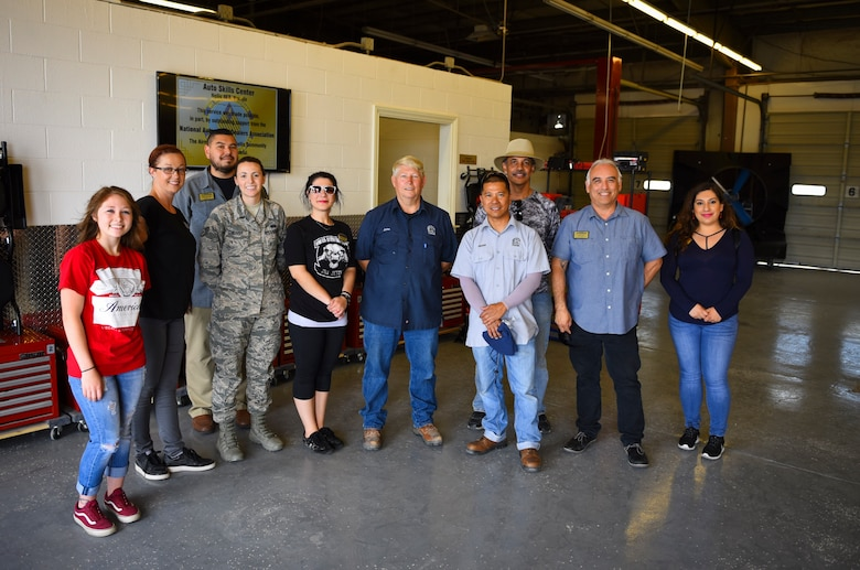 Members of the 99th Force Support Squadron celebrate the grand re-opening of the Auto Hobby Shop at Nellis Air Force Base, Nevada, May 31, 2018. The shop underwent major renovations to repair the facility as well as supply customers with the proper tools to perform maintenance on their vehicles. (U.S. Air Force photo by Airman 1st Class Andrew D. Sarver)