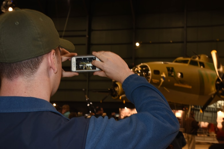 A museum visitor takes a picture of the B-17F Memphis Belle during the Memphis Belle exhibit opening events May 17-19, 2018. (U.S. Air Force photo by Ken LaRock)