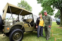 A WWII Veteran poses with a military reenactor during the Memphis Belle exhibit opening events May 17-19, 2018. (U.S. Air Force photo by Ken LaRock)