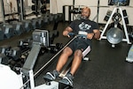 Tim Weatherspoon from DLA Energy relieves stress and improves his fitness on a rowing machine at the HQC Fitness Center. He took third place in the 500-meter and 1,000-meter rowing contest during the May Fitness Challenge May 14-17. Photo by Beth Reece