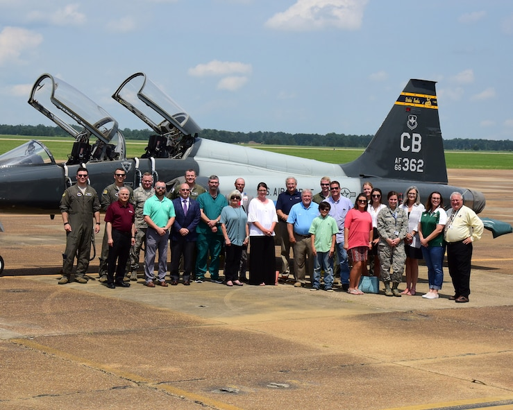 Members of the Pilot Partner Program and Team BLAZE members stand in front of a T-38C Talon during a base tour May 30, 2018, at Columbus Air Force Base, Mississippi. The Pilot Partner program pair local businesses with specialized undergraduate pilot training classes to help build base-community relations. (U.S. Air Force photo by Elizabeth Owens)