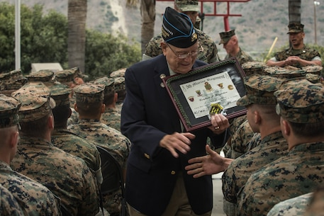 "Retired U.S. Marine Corps Chief Warrant Officer 4 Hershel ""Woody"" Williams, the last surviving Medal of Honor recipient of the battle of Iwo Jima, shakes hands with Marines during his visit to the 5th Marine Regiment Vietnam War Memorial at Marine Corps Base Camp Pendleton, Calif., May 29, 2018."