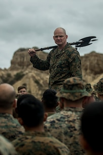 U.S. Marine Corps Lt. Col. Michael Nakonieczny, commanding officer of 1st Light Armored Reconnaissance Battalion, 1st Marine Division, holds the battalion's battle axe during Highlanders' Night at Marine Corps Base Camp Pendleton, Calif., May 24, 2018.