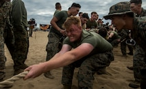 U.S. Marines, with 1st Light Armored Reconnaissance Battalion, 1st Marine Division, pull during the battalion's Highlanders' Night tug-of-war competition at Marine Corps Base Camp Pendleton, Calif., May 24, 2018