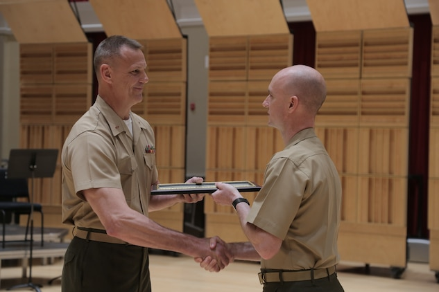 On June 1, 2018, Marine Band Director Col. Jason K. Fettig promoted newly-appointed Assistant Director Bryan Sherlock to the rank of captain in a ceremony in the John Philip Sousa Band Hall at the Marine Barracks Annex in Washington, D.C. (U.S. Marine Corps photo by Master Sgt. Kristin duBois/released)