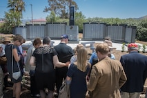 U.S. Marine Corps and Navy veterans observe the 5th Marines Vietnam War Memorial during the unveiling ceremony in the Camp San Mateo Memorial Garden at Marine Corps Base Camp Pendleton, Calif., May 28, 2018.