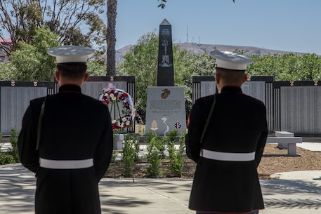 U.S. Marines with 5th Marine Regiment, 1st Marine Division, observe the 5th Marines Vietnam War Memorial unveiling ceremony in the Camp San Mateo Memorial Garden at Marine Corps Base Camp Pendleton, Calif., May 28, 2018.