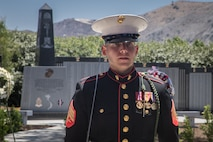 A U.S. Marine with 5th Marine Regiment, 1st Marine Division, marches by the 5th Marines Vietnam War Memorial during the unveiling ceremony in the Camp San Mateo Memorial Garden at Marine Corps Base Camp Pendleton, Calif., May 28, 2018.