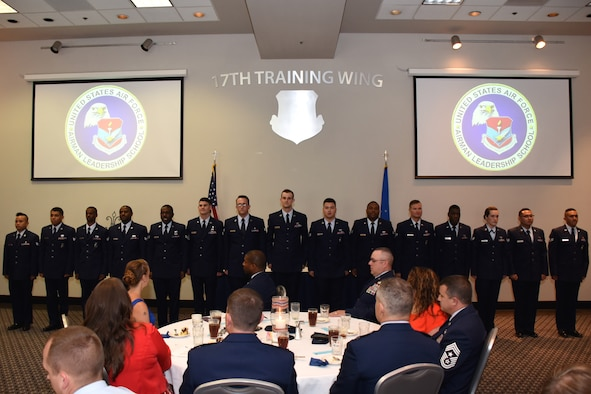 The Airman Leadership School Class 18-D stands for recognition one last time before ending the graduation ceremony in the Event Center on Goodfellow Air Force Base, Texas, May 31, 2018. ALS is a six-week course designed to prepare senior airmen to assume supervisory duties by offering instruction in leadership, followership, written and oral communication skills, and the profession of arms. (U.S. Air Force photo by Airman 1st Class Zachary Chapman/Released)