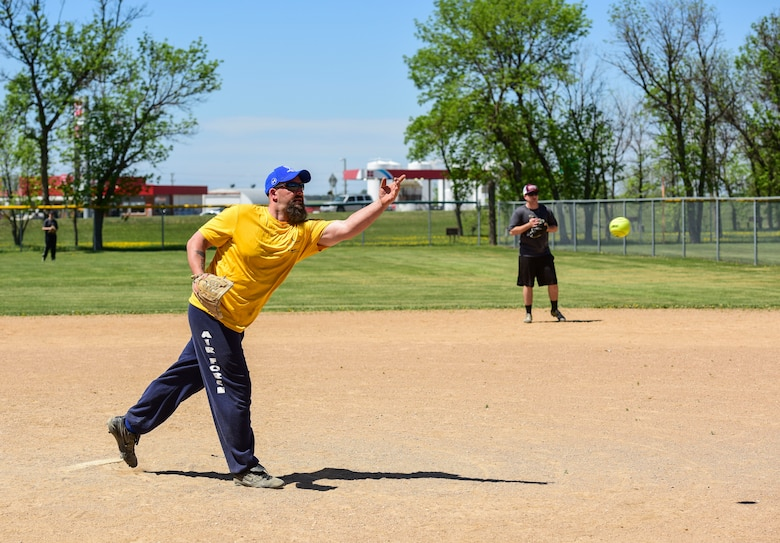 Team Minot faced-off against Team Grand Forks in the fourth annual Wingman Week softball tournament at Devils Lake, North Dakota, May 24, 2018.