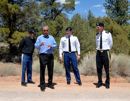Col. Kirk Gibbs, Los Angeles District commander (far left); Lt. Col. James Booth, Albuquerque District commander (center); and Brig. Gen. Peter Helmlinger, South Pacific Division Commander, listen to Garrett Silversmith, director of the Navajo Nation Department of Transportation discuss the soil stabilization done on this road, April 23, 2018.