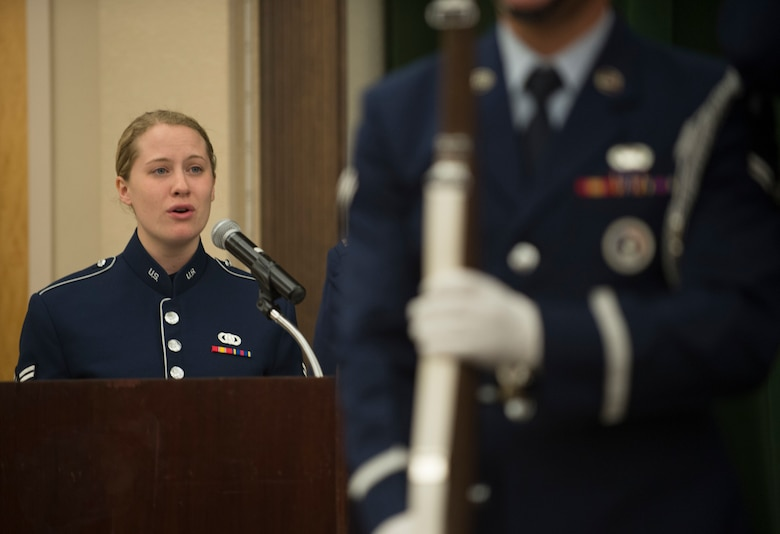 Airman 1st Class Amelia Acompanado, Air Force Band of the West vocalist, sings the national anthem at Brig. Gen. Mitchel Butikofer's, Air Forces Cyber vice commander, retirement ceremony at Joint Base San Antonio-Lackland, Texas, June 1, 2018. Butikofer retired after 29 years of service. (U.S. Air Force photo by Tech. Sgt. R.J. Biermann)