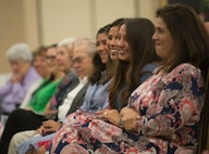 Brig. Gen. Mitchel Butikofer's, Air Forces Cyber vice commander, family share laughs during Butikofer's retirement ceremony at Joint Base San Antonio-Lackland, Texas, June 1, 2018. Butikofer retired after 29 years of service. (U.S. Air Force photo by Tech. Sgt. R.J. Biermann)