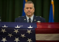 Brig. Gen. Mitchel Butikofer, Air Forces Cyber vice commander, stands at the position of attention as the U.S. flag is folded during his retirement ceremony at Joint Base San Antonio-Lackland, Texas, June 1, 2018. Butikofer retired after 29 years of service. (U.S. Air Force photo by Tech. Sgt. R.J. Biermann)