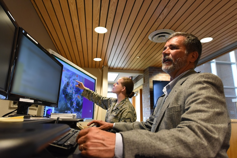 William Martin, the 28th Operations Support Squadron weather flight lead forecaster and Master Sgt. Jessica Leiker, the 28th OSS noncommissioned officer in charge of mission weather operations, observe weather forecasts at Ellsworth Air Force Base, S.D., May 29, 2018. The weather flight is responsible for providing accurate and timely weather forecasts to support operations on base which are critical to mission success. (U.S. Air Force photo by Airman 1st Class Thomas Karol)