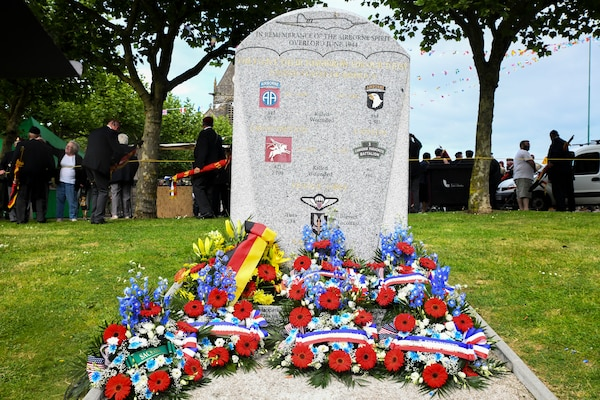 Ceremonial wreaths honoring allied airborne units who took part in Operation Overlord during June 1944 lay at the base of the Airborne Spirit Monument in Sainte-Mere-Eglise, France, in order to pay homage to the memory of the Americans who helped turn the tide of WWII, May 31, 2018. This year marks the 74th anniversary of Operation Overlord, the Allied invasion of Normandy on June 6, 1944 -- most commonly known as D-Day. Army photo by Staff Sgt. Tamika Dillard