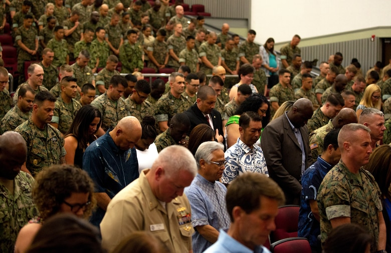 Marines and Sailors of 3rd Marine Logistics Group, family members and guests bow their heads during the invocation as part of the transfer of command ceremony June 1, 2018 at Camp Foster, Okinawa, Japan. Brig. Gen. Daniel B. Conley, commanding general of 3rd MLG, relinquished command of 3rd MLG to Col. Ronald C. Braney, the incoming commanding officer of 3rd MLG. Conley is a native of Falmouth, Massachusetts. Braney is a native of Manlius, New York. (U.S. Marine Corps photo by Cpl. Joshua Pinkney)