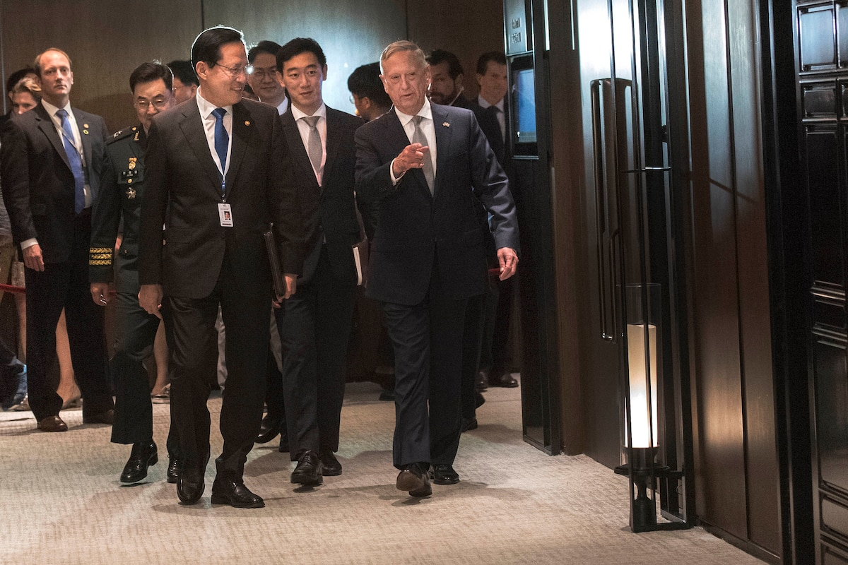 Defense Secretary James N. Mattis walks with South Korean Minister of Defense Song Young-moo.