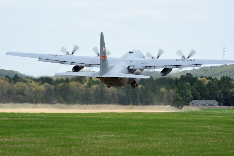 A C-130 Hercules from the 182nd Airlift Wing, Illinois Air National Guard, takes off from Young Landing Zone at Fort McCoy, Wis. May 14, 2018.  A number of pilots were qualifying to complete their unimproved landing certification. (U.S. Air National Guard photo by Master Sgt. Todd A. Pendleton)