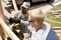 CE Structural airmen repairing a fence