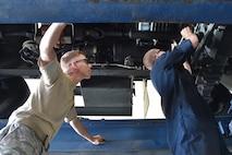 Mechanics changing a transmission filter