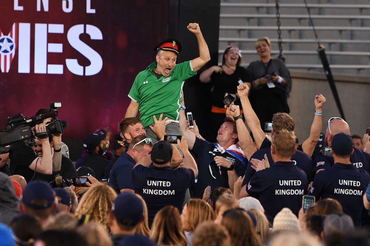 Movie and television personality Jon Stewart gets a lift by Team United Kingdom while hosting opening ceremonies for the 2018 Warrior Games at the U.S. Air Force Academy in Colorado Springs, Colo., June 2, 2018. DoD photo by EJ Hersom