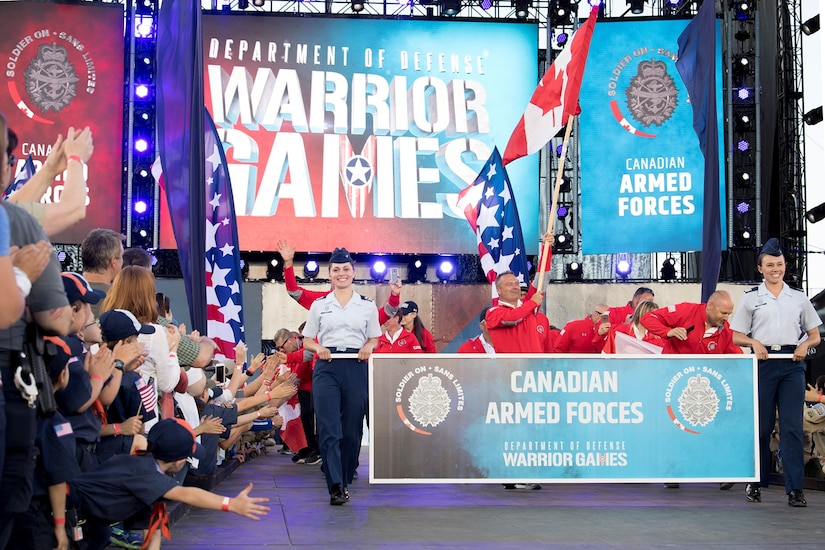 Team Canada officially enters its first DoD Warrior Games during opening ceremonies for the 2018 games at the U.S. Air Force Academy in Colorado Springs, Colo., June 2, 2018. DoD photo by EJ Hersom
