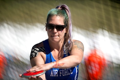 Medically retired Air Force Senior Airman Karah Behrend prepares to throw discus during the 2018 DoD Warrior Games at the U.S. Air Force Academy in Colorado Springs, Colo., June 2, 2018. The sisters met for the first time in person at the games. DoD photo by EJ Hersom