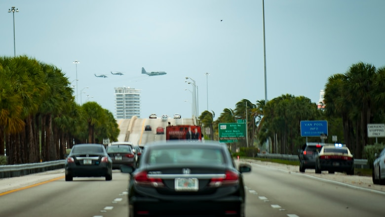 Air Force Reserve Citizen Airmen from the 920th Rescue Wing out of Patrick Air Force Base in Cocoa Beach, Florida fly past Miami Beach aboard an HC-130P/N King airplane and two HH-60G Pave Hawk helicopters on May 27th, 2018 during the 2nd annual Salute to American Heroes Air and Sea Show. This two-day event showcases military fighter jets and other aircraft and equipment from all branches of the United States military in observance of Memorial Day, honoring servicemembers who have made the ultimate sacrifice. (U.S. Air Force photo/Staff Sgt. Jared Trimarchi)
