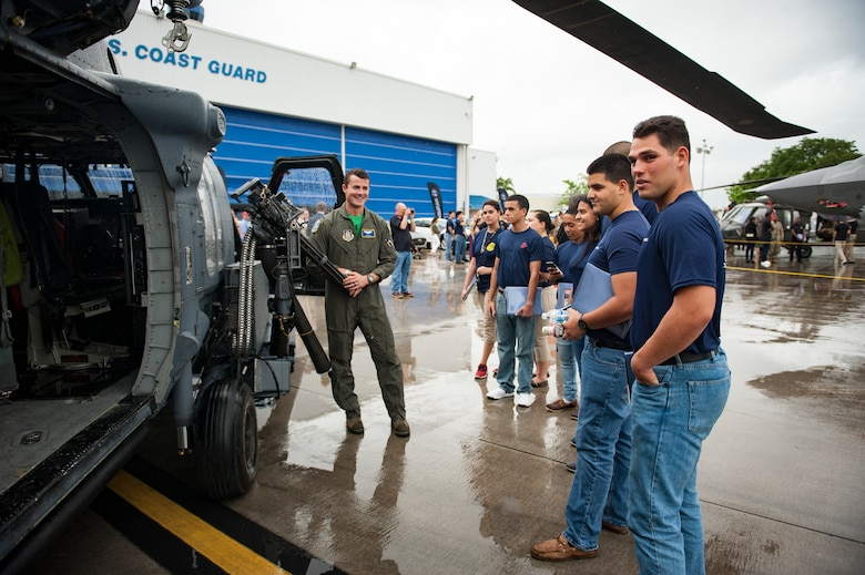Air Force Reserve Citizen Airman 1st Lt. Andy Deck from the 301st Rescue Squadron out of Patrick Air Force Base in Cocoa Beach, Florida, talks to a group of future servicemembers, May 25th, 2018, at Miami, after a practice run for the 2nd annual Salute to American Heroes Air and Sea Show over Miami Beach, Florida. This two-day event showcases military fighter jets and other aircraft and equipment from all branches of the United States military in observance of Memorial Day, honoring servicemembers who have made the ultimate sacrifice. (U.S. Air Force photo/Staff Sgt. Jared Trimarchi)
