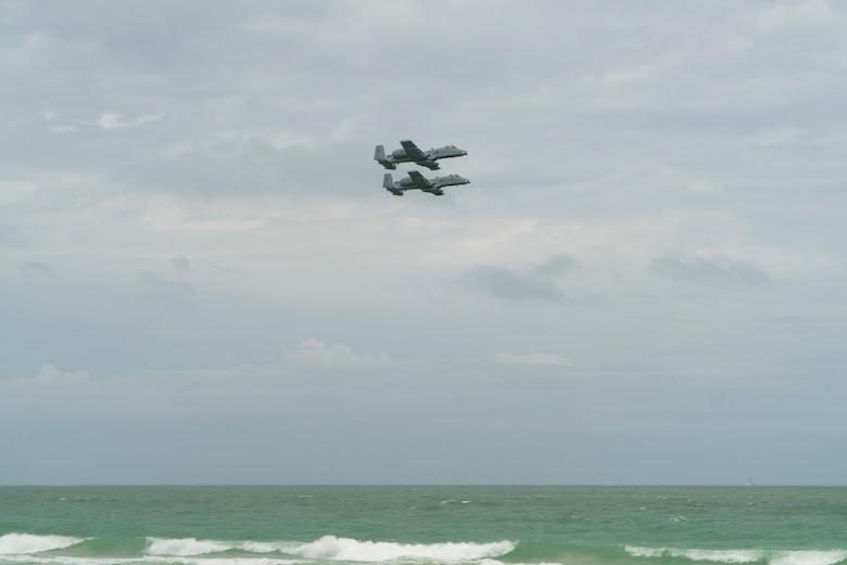 Two A-10 Thunderbolt IIs from the 442nd Fighter Wing fly in formation as part of a combat search and rescue demonstration with the 920th Rescue Wing over Miami Beach, Florida on May 26th, 2018 during the 2nd annual Salute to American Heroes Air and Sea Show. This two-day event showcases military fighter jets and other aircraft and equipment from all branches of the United States military in observance of Memorial Day. (U.S. Air Force Reserve video by Staff Sergeant Nicholas A. Priest)