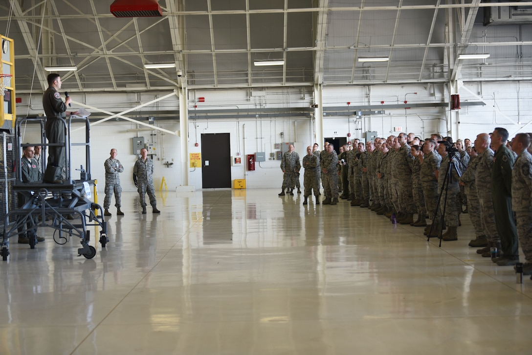 Maj. Robert Sandwith, 115th Fighter Wing chief of safety, addresses Airmen in hangar 406 during a safety briefing in Madison, Wis., June 3, 2018.