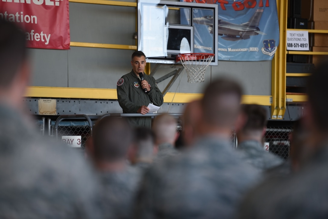 Col. Erik Peterson, 115th Fighter Wing commander, speaks to Airmen in hangar 406 during a safety briefing in Madison, Wis., June 3, 2018.
