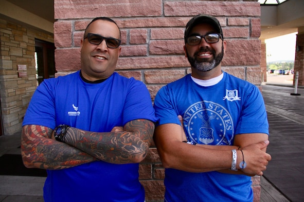 U.S. Air Force Master Sgt. Jose Rijos (left), 104th Fighter Wing Security Forces, stands with Master Sgt. Andres Rodriguez (right), 132nd Medical Group bioenvironmental engineer, May 29, 2018, in Colorado Springs, Colo. Rijos is here as a caregiver for Rodriguez, who is one of the 39 athletes representing Team Air Force during the 2018 Warrior Games. (U.S. Air Force photo by Jay Martinez)