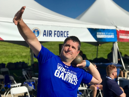Angel took home gold medals in the seated shot put and discus (4.0 classifications) during the first official day of Warrior Games events. (U.S. Air Force photo by Alexx Pons)