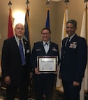 U.S. Air Force Col. Raymundo Luevanos, 446th Mission Support Group Commander, accepts the ESGR Seven Seals Award on behalf of the 446th Airlift Wing from ESGR State Chairman John Patterson alongside U.S. Air Force Maj. Brooke Davis, 446th AW Chief of Public Affairs, May 5, 2018 at Tacoma Wash. (Courtesy photo).