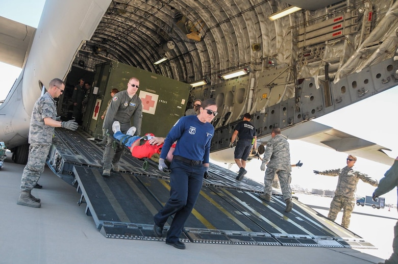 Reserve Citizen Airmen from Luke Air Force Base and Wright Patterson AFB work with local firefighters in transporting simulated patients during a National Disaster Mass Casualty exercise at the 161st Air Refueling Wing at Phoenix Sky Harbor.