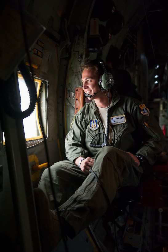"""Air Force Reserve Senior Airman Austin Schwier, with the 39th Rescue Squadron out of Patrick Air Force Base in Cocoa Beach, Florida, waits for the rain to clear aboard an HC-130- P/N """"King"""" on May 25th, 2018, at Miami, before a practice run for the 2nd annual Salute to American Heroes Air and Sea Show. This two-day event showcases military fighter jets and other aircraft and equipment from all branches of the United States military in observance of Memorial Day, honoring servicemembers who have made the ultimate sacrifice. (U.S. Air Force photo/Staff Sgt. Jared Trimarchi)"""