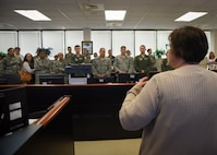 Team Dover members recieve briefing in C3.