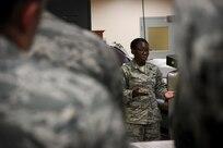 Staff Sgt. Michelle Johnson briefs during orientation at AFMAO.