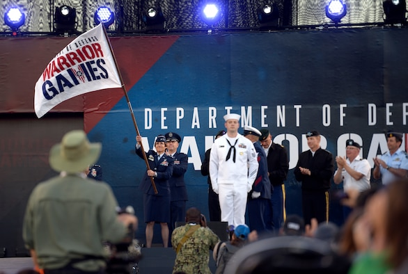 Lt. Gen. Gina M. Grosso, Deputy Chief of Staff for Manpower, Personnel and Services, waves the Department of Defense Warrior Games flag June 2, 2018, during the opening ceremony at the U.S. Air Force Academy's Falcon Stadium. First held in Colorado  Springs in 2010, the Warrior Games were established as a way to expose service members who were wounded, ill or injured to adaptive sports. The Air Force is the host service for this year's Games. (U.S. Air Force photo by Tech Sgt. Anthony Nelson Jr.)