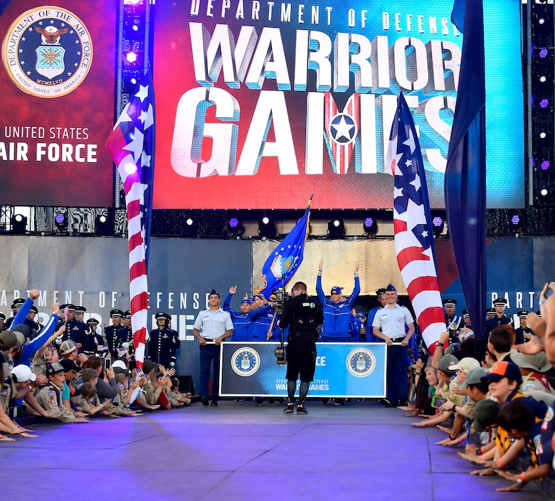 Team Air Force walks down the ramp during the opening ceremony of the Department of Defense Warrior Games at the U.S. Air Force Academy in Colorado Springs, Colorado, June 2, 2018. There are 39 athletes representing Team Air Force at the Games, competing against wounded, ill and injured service members and veterans representing the U.S. Army, Marine Corps, Navy, and Special Operations Command, as well as athletes from the United Kingdom Armed Forces, Australian Defence Force and Canadian Armed Forces. (U.S. Air Force photo by Staff Sgt. Rusty Frank)
