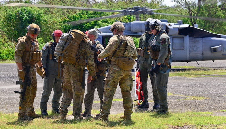 U.S. Air Force and U.S. Navy members perform search and rescue and medical evacuation operations in exercise COPE NORTH 18 over Tinian, U.S. Commonwealth of the Northern Marianas Islands, Feb. 21, 2018. COPE NORTH enables U.S. and allied forces to train humanitarian assistance/disaster relief operations from austere operating bases, enhancing our capacity and capability to respond in times of crisis. (U.S. Air Force photo by Airman 1st Class Christopher Quail)