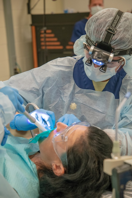 U.S. Air Force Maj. Matthew Moberg, 42nd Aerospace Medicine Squadron, Maxwell, Air Force Base, perform a dental procedure May 10, 2018, at Georgia Southern University in Savannah Georgia for Operation Empower Health. The Innovative Readiness Training is a U.S. military training opportunity that provides real-life deployment training and readiness for military personnel while addressing public and civil-society needs. (U.S. Air National Guard Photo by Tech. Sgt. John Galvin)