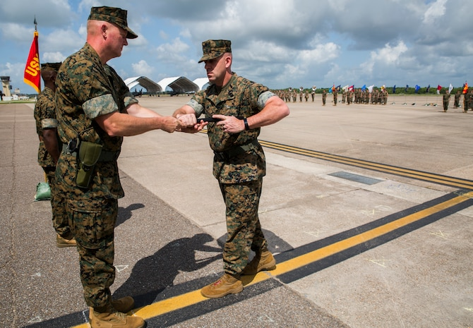 Brig. Gen. Bradley S. James, left, commander of 4th Marine Aircraft Wing, appoints Sgt. Maj. Thomas M. Burkhardt, right, as the new sergeant major of 4th MAW during a relief and appointment ceremony held at the Marine Light Attack Helicopter Squadron 773, Marine Aircraft Group 49, 4th MAW, airfield, New Orleans, June 2, 2018. Burkhardt is replacing Sgt. Maj. Rodney L. Lane, who served as the 4th MAW sergeant major from 2016-2018. (U.S. Marine Corps photo by Sgt. Melissa Martens)
