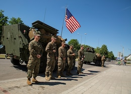 U.S. Marines participating in Exercise Saber Strike 18 stand outside of a U.S. Marine Corps Light Armored Vehicle (LAV) during a static-display event demonstrating military vehicles and gear in Kuršėnai, Lithuania, June 1, 2018. The multinational civil engagement gave the citizens of Kuršėnai the opportunity to interact with the different militaries involved in Exercise Saber Strike 18. Saber Strike is a U.S. joint and multinational exercise conducted at various locations throughout the Baltic States and Poland. The annual exercise prepares Allies to respond to regional crises and enhance the NATO alliance throughout the region. (U.S. Marine Corps photo by Sgt. Adwin Esters/Released)