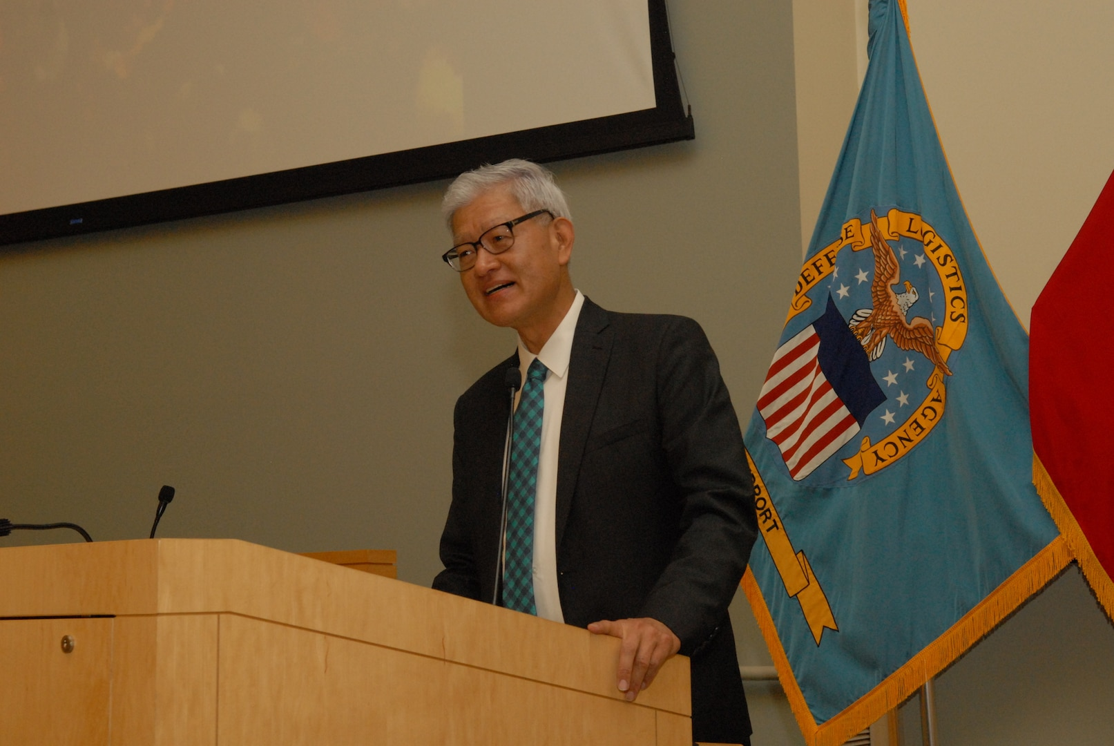 Architect, engineer and entrepreneur Timothy Haahs speaks to DLA Troop Support and NAVSUP Weapons Systems Support employees during an Asian American Pacific Islander Heritage Month event in Philadelphia May 24, 2018. Haahs discussed his experiences growing up in a leper colony in South Korea, coming to the U.S. when he was 12 years old, receiving two heart transplants and becoming a U.S. Senate-confirmed appointee to the Board of Directors of the National Institute of Building Sciences.