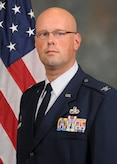 Col. Travis Caughlin, 507th Maintenance Group commander, stands for an official photograph at Tinker Air Force Base, Oklahoma. (U.S. Air Force photo)