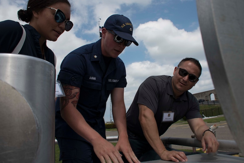 A U.S. Coast Guardsmen teaches Ashley Henning and Mario Chavez about the mission of Buffalo Sector of the USCG at Niagara Falls, New York, May, 31 2018.  Henning and Chavez, along with 28 other civilian leaders from the Greater Shreveport/Bossier City area, took part in a Civic Leader Tour hosted by the Niagara Falls Air Reserve Station, New York.  The tour allowed the leaders to learn more about Air Force and other military units outside Louisiana.  (U.S. Air Force photo by Master Sgt. Ted Daigle/released)